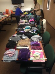 Hats, scarves, and gloves are sorted to distribute to veterans in need.